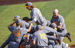 Tennessee outfielder Jordan Beck (27) jumps on the pile as they celebrate after an NCAA college baseball super regional game Sunday, June 13, 2021, in Knoxville, Tenn. Tennessee won 15-6 to advance. (AP Photo/Wade Payne)