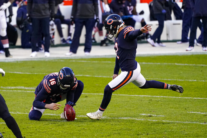Chicago Bears kicker Cairo Santos (2) kicks a field goal from the hold of Pat O'Donnell in the first half of an NFL football game against the New Orleans Saints in Chicago, Sunday, Nov. 1, 2020. (AP Photo/Charles Rex Arbogast)
