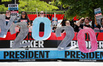 Supporters for Democratic presidential candidate Cory Booker hold signs outside the Iowa Democratic Party's Hall of Fame Celebration, Sunday, June 9, 2019, in Cedar Rapids, Iowa. (AP Photo/Charlie Neibergall)