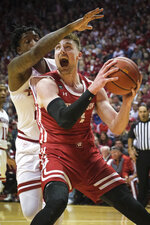 Wisconsin forward Micah Potter, right, moves around Indiana forward De'Ron Davis in the second half of an NCAA college basketball game in Bloomington, Ind., Saturday, March 7, 2020. Wisconsin won 60-56. (AP Photo/AJ Mast)