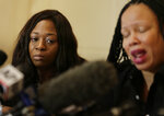 Rochelle Washington, left, cries as Latresa Scaff details their sexual misconduct accusations against musician R. Kelly during a news conference in New York, Thursday, Feb. 21, 2019. Scaff and Washington are accusing Kelly of sexual misconduct on the night they attended his concert while they were teenagers. (AP Photo/Seth Wenig)