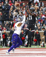 Cincinnati wide receiver Jayshon Jackson (21) scores a touchdown as East Carolina defensive back Khalil Barrett (22) defends during an NCAA college football game, Friday, Nov. 23, 2018, in Cincinnati.   (Kareem Elgazzar/The Cincinnati Enquirer via AP)