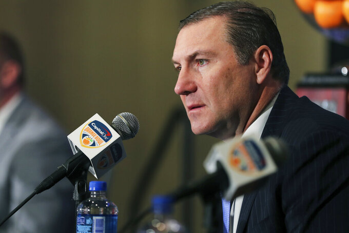 Florida Gators head coach Dan Mullen listens during a news conference for the Orange Bowl NCAA college football game, Sunday, Dec. 29, 2019, in Fort Lauderdale, Fla. Florida plays Virginia in the Orange Bowl on Dec. 30. (AP Photo/Mario Houben)