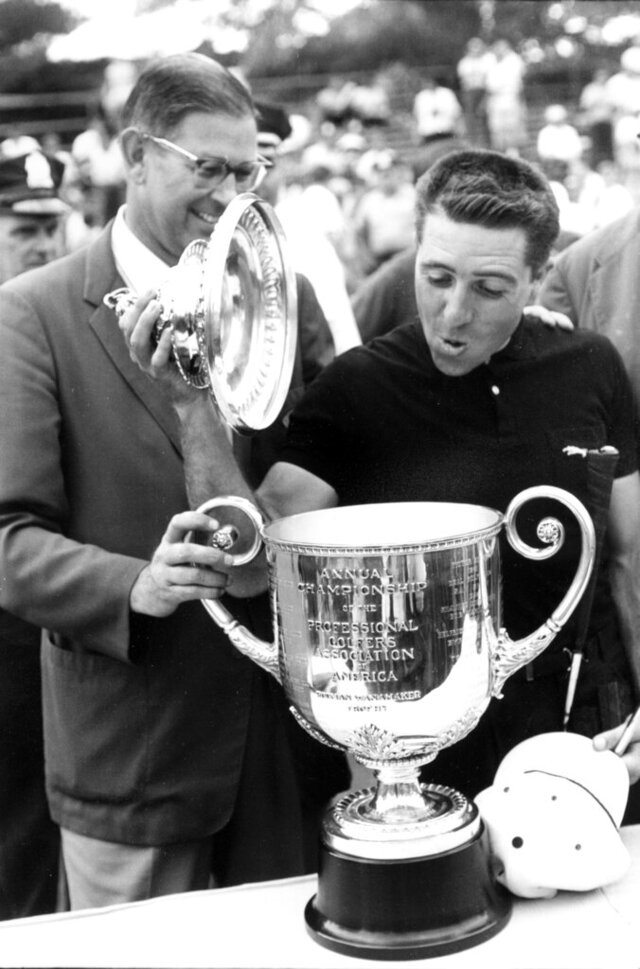 FILE - In this July 22, 1962, file photo, Gary Player lifts the top of the PGA trophy after winning the Championship at Aronimink Golf Club at Newton Square, Pa. At left is Lou Strong, Professional Golfer's Association president. Player was back Saturday at Aronimink Golf Club, home of this weekend's Women's PGA Championship, and the site of his 1962 PGA Championship victory. (AP Photo/File)