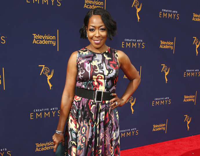 FILE - In this Sept. 8, 2018 file photo, Tichina Arnold arrives at the Television Academy's 2018 Creative Arts Emmy Awards in Los Angeles. Arnold stars in the CBS comedy series