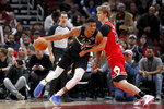Milwaukee Bucks' Giannis Antetokounmpo, left, drives against Chicago Bulls' Lauri Markkanen during the first half of an NBA basketball game Monday, Nov. 18, 2019, in Chicago. (AP Photo/Charles Rex Arbogast)