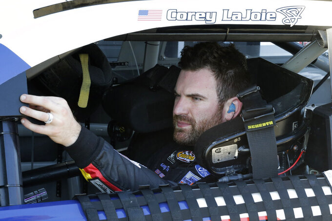 Corey LaJoie waits in his car during a NASCAR auto race practice at Daytona International Speedway, Saturday, Feb. 8, 2020, in Daytona Beach, Fla. (AP Photo/Terry Renna)