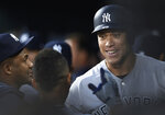 New York Yankees' Aaron Judge, right, smiles in the dugout after his solo home run during the first inning against the Baltimore Orioles in a baseball game Saturday, April 6, 2019, in Baltimore. (AP Photo/Gail Burton)