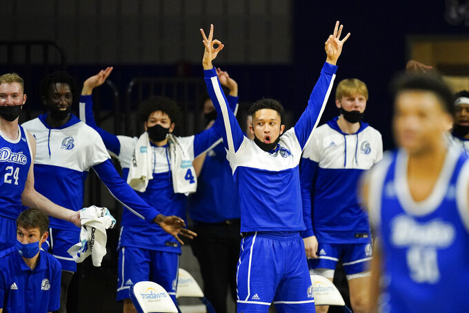 Drake players celebrate on the bench during the first half of an NCAA college basketball game against Illinois State, Monday, Feb. 1, 2021, in Des Moines, Iowa. (AP Photo/Charlie Neibergall)