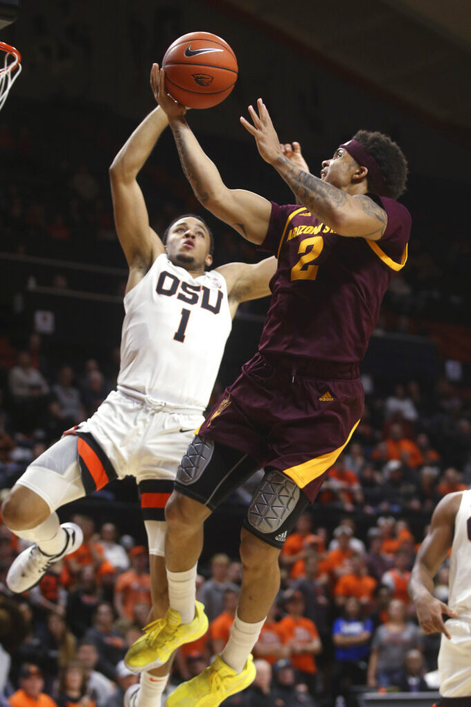 Arizona State's Rob Edwards, right, goes up for a shot against Oregon State's Sean Miller-Moore during the second half of an NCAA college basketball game in Corvallis, Ore., Thursday, Jan. 9, 2020. (AP Photo/Chris Pietsch)