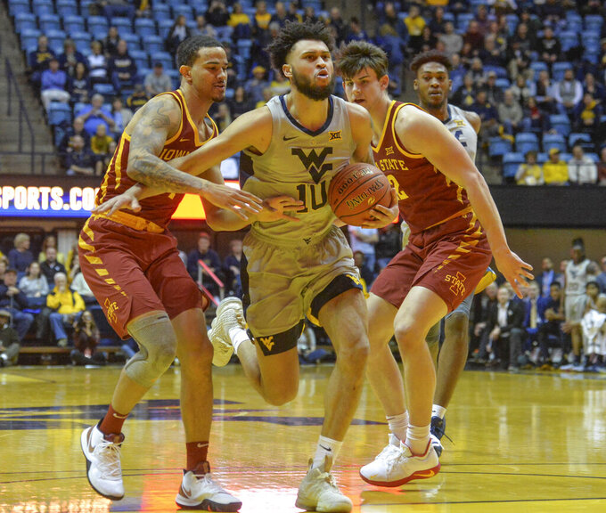 West Virginia guard Jermaine Haley (10) works the ball past Iowa State guard Nick Weiler-Babb, left, during the first half of an NCAA college basketball game Wednesday, March 6, 2019, in Morgantown, W.Va. (William Wotring/The Dominion-Post via AP)
