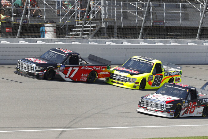 Matt Crafton (88) hits Tyler Ankrum (17) to set off a crash during a restart during a NASCAR Truck Series race at Michigan International Speedway in Brooklyn, Mich., Saturday, Aug. 10, 2019. (AP Photo/Paul Sancya)