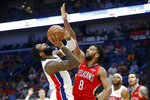 Detroit Pistons center Andre Drummond (0) shoots the ball in front of New Orleans Pelicans center Jahlil Okafor (8) in the first half of an NBA basketball game in New Orleans, Monday, Dec. 9, 2019. (AP Photo/Brett Duke)