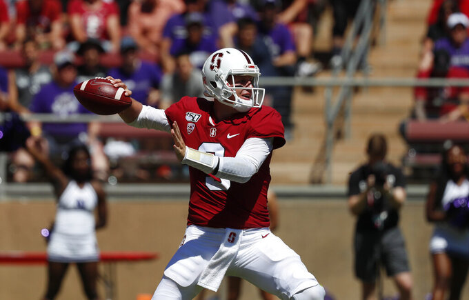 Stanford quarterback K.J. Costello (3) throws a pass against Northwestern in the second quarter of an NCAA college football game in Stanford, Calif., Saturday, Aug. 31, 2019. (AP Photo/Josie Lepe)