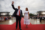 FILE - In this July 4, 2019, file photo President Donald Trump and first lady Melania Trump leave an Independence Day celebration in front of the Lincoln Memorial in Washington. Government watchdogs say President Trump's 2019 Fourth of July gala in the nation's capital cost taxpayers more than $13 million, twice as much as previous celebrations. (AP Photo/Carolyn Kaster, File)