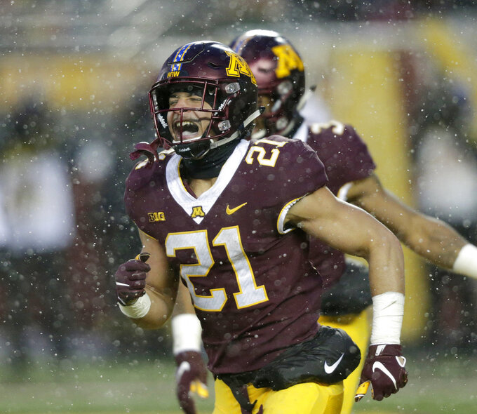 Minnesota running back Bryce Williams (21) celebrates his touchdown during the third quarter against Purdue in a NCAA college football game Saturday, Nov. 10, 2018, in Minneapolis. (AP Photo/Andy Clayton-King)