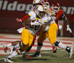Wyoming running back Jevon Bigelow looks for room to run against Fresno State defenders during the first half of an NCAA college football game in Fresno, Calif., Saturday, Oct. 13, 2018. (AP Photo/Gary Kazanjian)