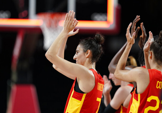 Spain's Alba Torrens (7), left, and teammates celebrate their win in the women's basketball preliminary round game against Canada at the 2020 Summer Olympics, Sunday, Aug. 1, 2021, in Saitama, Japan. (AP Photo/Charlie Neibergall)