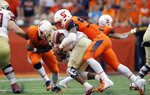 FILE - In this Sept. 15, 2018, file photo, Syracuse's Jake Pickard, right, sacks Florida State's Deondre Francois in the fourth quarter of an NCAA college football game in Syracuse, N.Y. Florida State (1-2) has allowed 10 sacks and generated only 156 rushing yards in its FBS losses, managing just a field goal and a touchdown in lopsided losses to Virginia Tech and at Syracuse. (AP Photo/Nick Lisi, File)