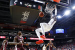 Cincinnati's Tre Scott dunks as Alabama A&M's Cameron Alford (13) watches during the first half of an NCAA college basketball game Thursday, Nov. 14, 2019, in Cincinnati. (AP Photo/John Minchillo)