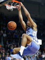 North Carolina's Garrison Brooks dunks during the second half of an NCAA college basketball game against Boston College in Boston, Tuesday, March 5, 2019. (AP Photo/Michael Dwyer)