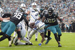 Indianapolis Colts running back Marlon Mack, center, scores on a 5-yard touchdown run past the Jacksonville Jaguars defense during the first half of an NFL football game, Sunday, Dec. 29, 2019, in Jacksonville, Fla. (AP Photo/Phelan M. Ebenhack)