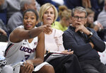 Connecticut's Megan Walker, left, gestures to her team as associate head coach Chris Dailey, center, and head coach Geno Auriemma, right, look on during the second half of an NCAA college exhibition basketball game against Jefferson, Sunday, Nov. 3, 2019, in Storrs, Conn. (AP Photo/Jessica Hill)