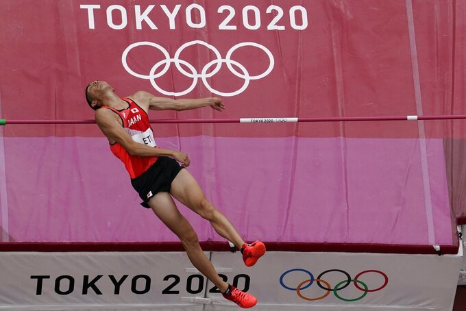 Takashi Eto, of Japan, competes during a preliminary round of the men's high jump at the 2020 Summer Olympics, Friday, July 30, 2021, in Tokyo. (AP Photo/Morry Gash)