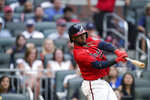 Atlanta Braves' Ozzie Albies hits a single during the first inning of the team's baseball game against the Los Angeles Dodgers on Friday, June 4, 2021, in Atlanta. (AP Photo/Brynn Anderson)