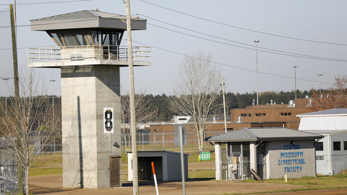 In this March 20, 2019 photo, a watch tower stands high on the grounds of the Central Mississippi Correctional Facility in Pearl, Miss. Mississippi's habitual offender laws are causing