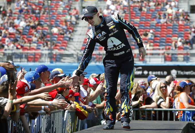 William Byron is greeted by fans during driver introductions prior to the start of the NASCAR Cup Series auto race at ISM Raceway, Sunday, March 10, 2019, in Avondale, Ariz. (AP Photo/Ralph Freso)