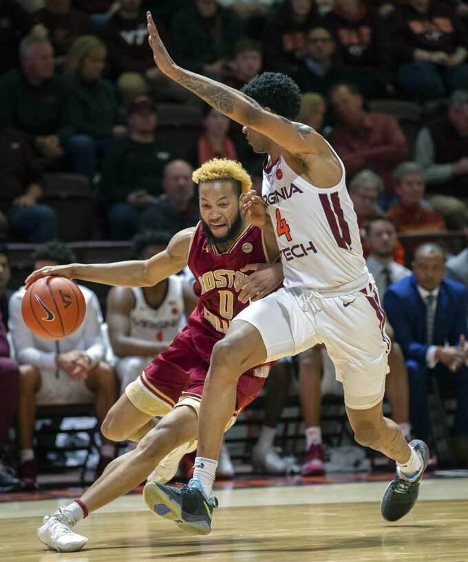 Boston College guard Ky Bowman (0) drives against Virginia Tech guard Nickeil Alexander-Walker (4) during the first half of an NCAA college basketball game Saturday, Jan. 5, 2019, in Blacksburg, Va. (AP Photo/Don Petersen)
