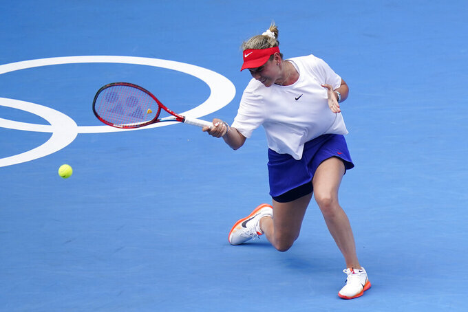 Donna Vekic, of Croatia, returns to Aryna Sabalenka, of Belarus, during second round of the tennis competition at the 2020 Summer Olympics, Monday, July 26, 2021, in Tokyo, Japan. (AP Photo/Patrick Semansky)