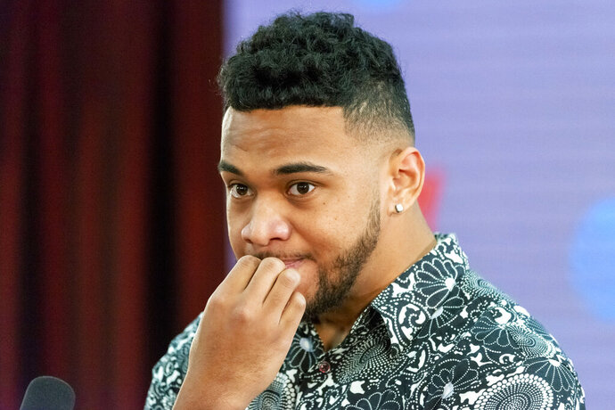 Alabama quarterback Tua Tagovailoa takes questions after announcing his intentions to declare for the 2020 NFL football  draft, Monday, Jan. 6, 2020, in Tuscaloosa, Ala. (AP Photo/Vasha Hunt)