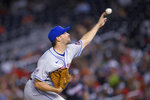 New York Mets starter Rich Hill delivers a pitch during the third inning of the team's baseball game against the Washington Nationals, Friday, Sept. 3, 2021, in Washington. (AP Photo/Nick Wass)
