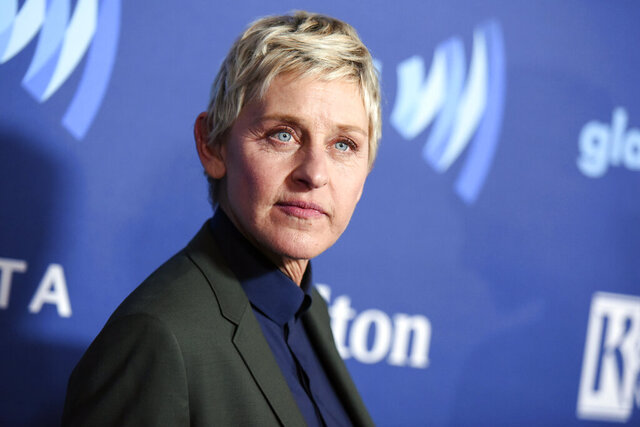 """FILE - Ellen DeGeneres arrives at the 26th Annual GLAAD Media Awards in Beverly Hills, Calif., on March 21, 2015. DeGeneres said she has tested positive for COVID-19 but is """"feeling fine right now."""" The producer of her daytime talk show says production has been put on hold until January. (Photo by Richard Shotwell/Invision/AP, File)"""