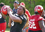 In this Wednesday, Aug. 1, 2018 photo, Utah's defensive tackle Leki Fotu looks on during NCAA college football practice in Salt Lake City. Strong defensive lines are a trademark of Utah's football program. After experiencing a drop-off in production along the line of scrimmage a year ago, the Utes are focused on re-establishing their dominance up front this season. (AP Photo/Rick Bowmer)