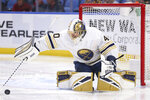 Buffalo Sabres goalie Carter Hutton (40) covers the puck during the second period of an NHL hockey game against the Columbus Blue Jackets, Thursday, Feb. 13, 2020, in Buffalo, N.Y. (AP Photo/Jeffrey T. Barnes)