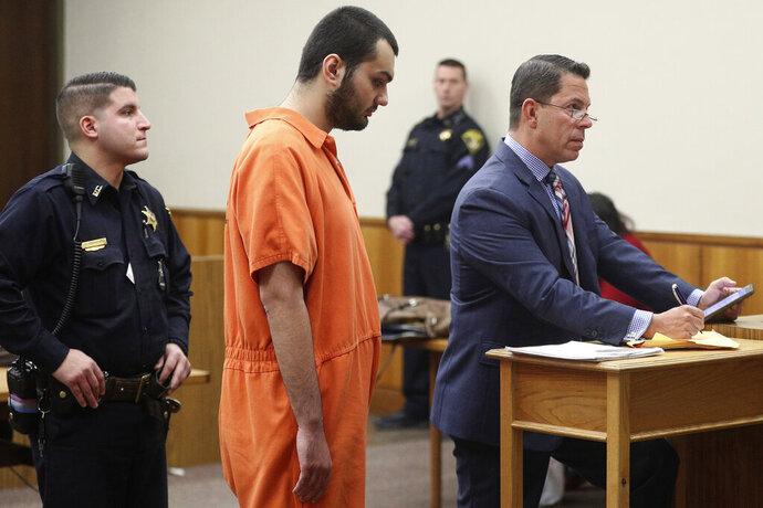 Vincent Vetromile appears in court with his attorney Stephen Sercu in Rochester, N.Y., on Thursday, March 7, 2019. Vetromile and three others are charged with plotting to attack an Islamic community in upstate New York. (Jamie Germano/Democrat & Chronicle via AP, Pool)