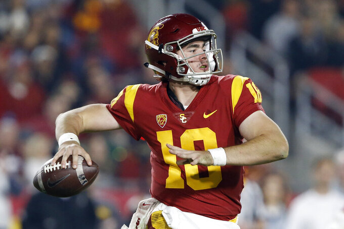 FILE - In this Nov. 10, 2018, file photo, Southern California quarterback JT Daniels (18) throws a pass during the second half of an NCAA college football game against California in Los Angeles. Sophomore J.T. Daniels was resolute he is the best man for the job after retaining his starting job. (AP Photo/Alex Gallardo, File)