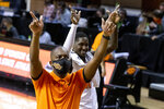 Oklahoma State head coach Mike Boynton Jr., front, and Ferron Flavors Jr. celebrate at the end of an NCAA college basketball game against Oakland in Stillwater, Okla., Saturday, Dec. 5, 2020. (AP Photo/Mitch Alcala)