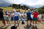 Spectators along the road applaud the riders during the nineteenth stage of the Tour de France cycling race over 126,5 kilometers (78,60 miles) with start in Saint Jean De Maurienne and finish in Tignes, France, Friday, July 26, 2019. (AP Photo/Thibault Camus)