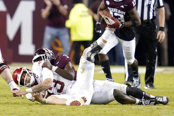Texas A&M defensive lineman Tyree Johnson (3) sacks Arkansas quarterback Feleipe Franks (13) for a loss during the second quarter of an NCAA college football game Saturday, Oct. 31, 2020, in College Station, Texas. (AP Photo/Sam Craft)