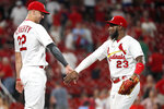 St. Louis Cardinals' Marcell Ozuna (23) and Jack Flaherty (22) celebrate a victory over the Washington Nationals in a baseball game Monday, Sept. 16, 2019, in St. Louis. (AP Photo/Jeff Roberson)