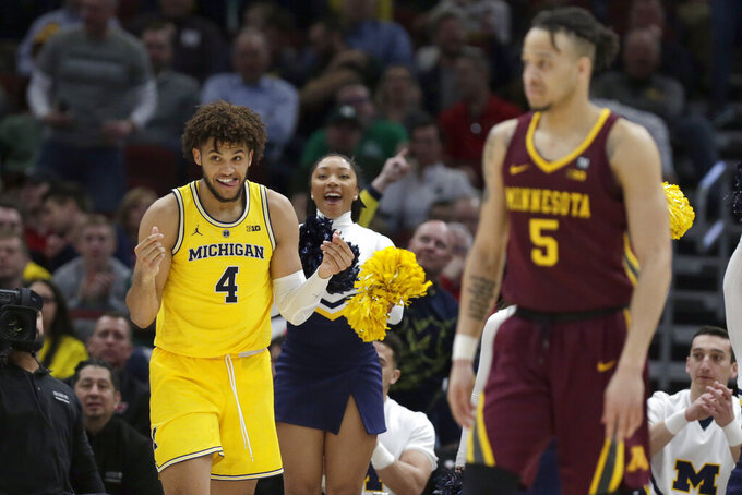 Michigan's Isaiah Livers (4) reacts after making a shot during the second half of an NCAA college basketball game against Minnesota in the semifinals of the Big Ten Conference tournament, Saturday, March 16, 2019, in Chicago. (AP Photo/Kiichiro Sato)