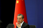 Chinese Foreign Minister Wang Yi answers media questions during a press conference on the upcoming Road and Belt Forum in Beijing on Friday, April 19, 2019. China is downplaying the political implications of its global development campaign known as the Belt and Road initiative, saying that it aims to boost multilateralism amid protectionist trends in the U.S. and elsewhere. (AP Photo/Ng Han Guan)
