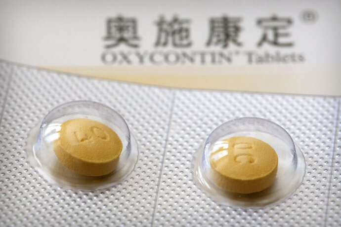 This Sept. 24, 2019 photo shows 40-milligram OxyContin tablets sold in China in Hunan province. OxyContin's U.S. FDA-approved label warns that even if taken as prescribed, the opioid carries potentially lethal risks of addiction and abuse. (AP Photo/Mark Schiefelbein)