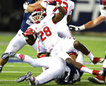"FILE - In this May. 17, 2020, file photo, Fresno State's Dontel James is tackled by Utah State's Chase Christiansen during an NCAA college football game in Logan, Utah. San Diego State is looking at having football players return to campus no earlier than July 7 and is making plans to play the season as scheduled, athletic director J.D. Wicker said. SDSU is proceeding because it envisions a fall schedule that includes a hybrid model of classes, in which some students will be on campus for in-person instruction such as labs, while other classes will be online. NCAA President Mark Emmert said recently that campuses must be open ""in one fashion or another"" in order to have sports this fall. (John Zsiray/Herald Journal via AP)"