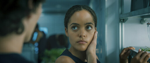 """This image released by Lionsgate shows Quintessa Swindell in a scene from """"Voyagers."""" (Lionsgate via AP)"""