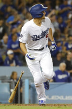 Los Angeles Dodgers' Corey Seager watches his two-run double against the Tampa Bay Rays during the fifth inning of a baseball game in Los Angeles, Tuesday, Sept. 17, 2019. (AP Photo/Chris Carlson)